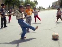 Iraq - Iraqi children play football at an empty street in Baghdad, 09Apr2007