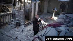 NAGORNO-KARABAKH -- Arthur Sahakyan, 63, prays inside the damaged Holy Savior Cathedral of Shushi/Shusha, October 13, 2020.