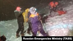 Members of the Emergency Situations Ministry conduct a rescue operation after the group of climbers got stuck on Mount Elbrus.