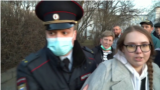 Russia - protest in support of Aleksei Navalny - protester being detained by police - Reuters screen grab