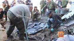 В Донецком аэропорту прошла эксгумация погибших военных