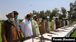Members of the Taliban hand over their weapons in Jalalabad, Afghanistan on June 25.