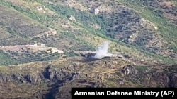 Azerbaijan -- A video grab shows the smoke from the explosions of the shelling by Armenian forces of an Azerbaijani army position in the Tovuz region, July 14, 2020.