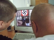 Russia - The web video shows the victims kneeling in front of a Nazi flag, 14Aug2007