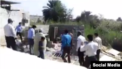 Iranian social media showing officers from the Bandar Abbas municipality destroying