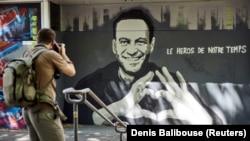 A portrait of Aleksei Navalny by Swiss artists Julien Baro & Lud is displayed ahead of the June 16 summit in the Swiss city between U.S. President Joe Biden and Russian President Vladimir Putin in Geneva.