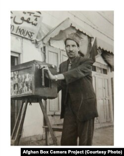 Kabul-based photographer Abdul Samad in the late 1950s with his box camera.