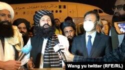 Taliban Refugees Minister Khalil ur-Rahman Haqqani receives a shipment of humanitarian aid from Chinese diplomats at Kabul airport on September 30.