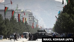 Taliban fighters block a road with a Humvee near Kabul airport on August 28.