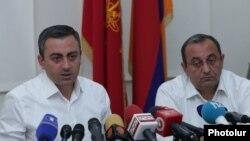 Armenia - Ishkhan Saghatelian (L) and Artsvik Minasian, leaders of the Dashnaktsutyun party allied to former President Robert Kocharian, hold a news conference in Yerevan, July 6, 2021.