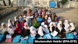Afghan children attend an open-air class due to the lack of school facilities in the Sarhood district of Nangarhar Province on February 25.