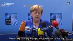Merkel Defends Germany's NATO Record