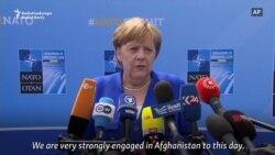 Merkel Defends Germany's NATO Record