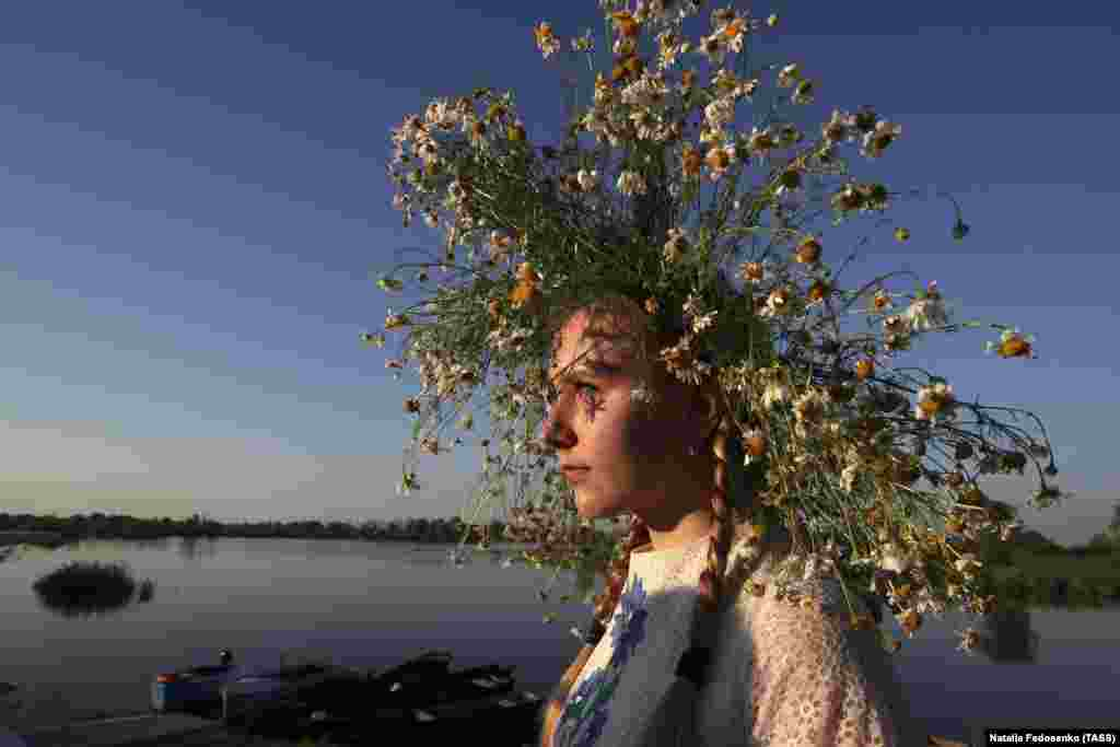 A girl wears a flower wreath. Initially, Ivana-Kupala was a pagan fertility rite that was also connected to the celebration of the summer solstice. After Christianity arrived, the rites were intertwined with the Christian feast of the Nativity of John the Baptist.