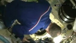 Russian-U.S. Crew Arrives At International Space Station