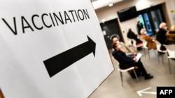 Указатель в клинике, где проводят вакцинацию от COVID-19. Восточная часть Франции, 21 января 2021 года.
