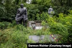 "Poliske, Ukraine. A simple dedication on this overgrown memorial reads: ""1941-1945. We remember."""