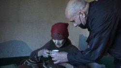 A Kosovar Albanian Cares For 92-Year-Old Ethnic Serb In An Abandoned Village