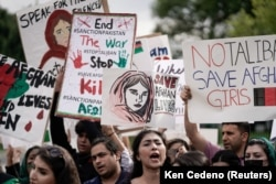 Demonstrators gather in front of the White House in Washington on August 15, as Taliban insurgents entered Kabul.