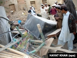 Hayatullah Khan's photo taken on December 1, 2005, shows local tribesmen inspecting the debris of a house in a village north of Mir Shah, Pakistan, that was destroyed by two alleged U.S. reconnaissance aircraft.