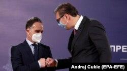 Српскиот претседател Александар Вучиќ и германскиот министер за надворешни работи Хajко Мас во Белград, 23 април 2021 година