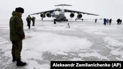 A Russian officer stands near a military cargo plane near Nagurskoye, Russia's northernmost military outpost.