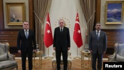 Turkey -- Turkish President Recep Tayyip Erdogan meets with Azerbaijan's Foreign Minister Jeyhun Bayramov (L) and Defence Minister Zakir Hasanov in Ankara, August 11, 2020.