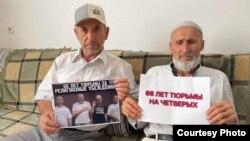 Активисты с портретом фигурантов алуштинского «дела Хизб ут-Тахрир»