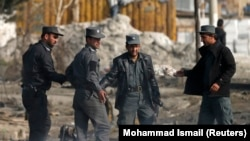 Paramilitary police from the Afghan Interior Ministry at the scene of a bomb attack in Kabul in November 2014