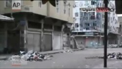 Embattled Syrian Rebels Withdraw From Parts Of Homs