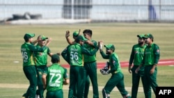 Pakistan's cricket team celebrates during a match with Zimbabwe in September. (file photo)