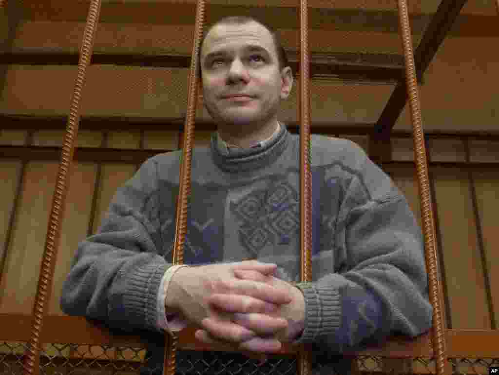 Russian nuclear scientist Igor Sutyagin stands behind bars on April 7, 2004, as he listens to a guilty verdict in a Moscow courtroom. Sutyagin was among four convicted spies pardoned by Medvedev to be exchanged for 10 Russians accused of spying in the United States.