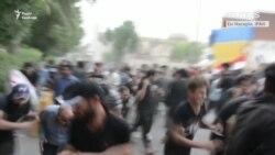 Протестувальники в Іраку втікають від пострілів (відео)