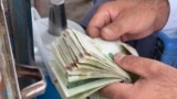 With Their Economy Close To Collapse, Some Afghans Switch To Iranian Currency video grab 2