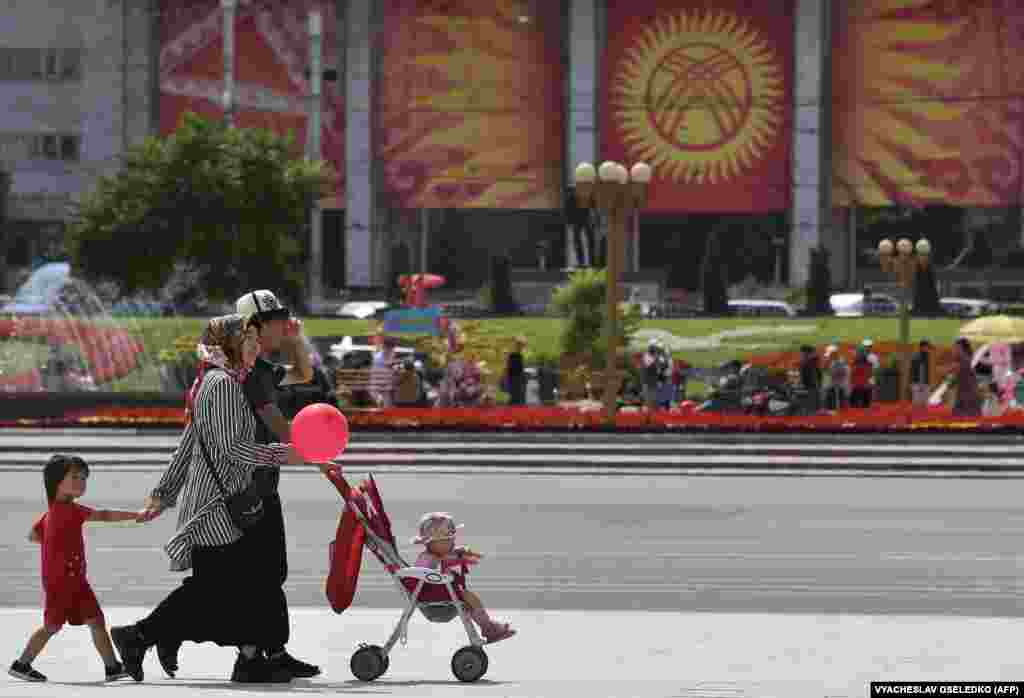 A Kyrgyz family takes part in the comemorations.