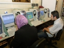 Iran - An Iranian couple in an Internet cafe in Tehran, May2004