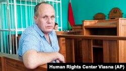 Belarusian journalist Syarhey Hardzievich in a courtroom in Minsk on August 2.