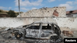 NAGORNO-KARABAKH -- A burnt car is seen outside a hospital, which, according to the Ministry of Foreign Affairs of the Nagorno-Karabakh region, was damaged during recent shelling in Martakert, Ocober 15, 2020