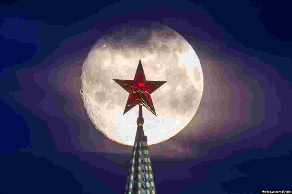 A full moon shines behind the Vodovzvodnaya Tower of the Kremlin in Moscow. (TASS/Marina Lystseva)