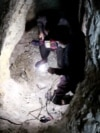 Digging And Desperate: Afghans Risk Lives To Illegally Mine Gold video grab 2