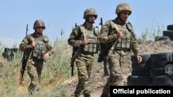 Armenia - Armenian soldiers walk through their positions along Armenia's border with Azerbaijan's Nakhichevan exclave, July 22, 2021.