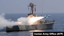 A handout picture provided by Iran's military shows a Nasr missile being fired from a navy warship during a military exercise.