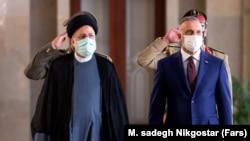 Iranian President Ebrahim Raisi (left) welcomes Iraqi Prime Minister Mustafa al-Kadhimi to Tehran on September 12.