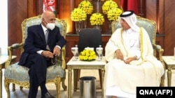 Qatari Foreign Minister Sultan bin Saad Al-Muraikhi (right) meets with Afghani President Ashraf Ghani in Doha on October 5.