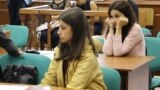 Two of the three sisters accused of killing their father, Angelina Khachaturyan (front) and Krestina Khachaturyan (back), at a court hearing in Moscow. (file photo)