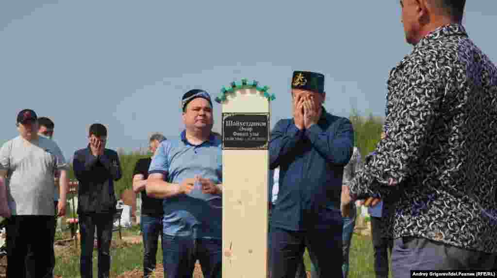 People attend the funeral of Amir Shaikhutdinov, 14, on May 12. Amir's classmates Ilzia Nagimullina and Damir Gaynutdinov were also buried.