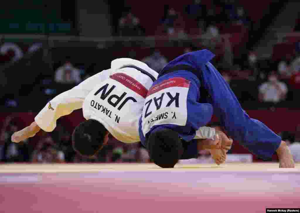 Naohisa Takato of Japan in action against Yeldos Smetov of Kazakhstan at Nippon Budokan in Tokyo, Japan, July 24, 2021.Yeldos Smetov of Kazakhstan took the bronze.