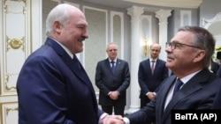 The optics were awkward as Belarusian strongman Alyaksandr Lukashenka warmly greeted the head of the International Ice Hockey Federation, Rene Fasel (right), in Minsk.