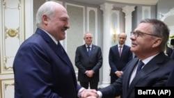 Belarusian President Alyaksandr Lukashenka (left) meeting with Rene Fasel, the head of the International Ice Hockey Federation, in Minsk on January 11