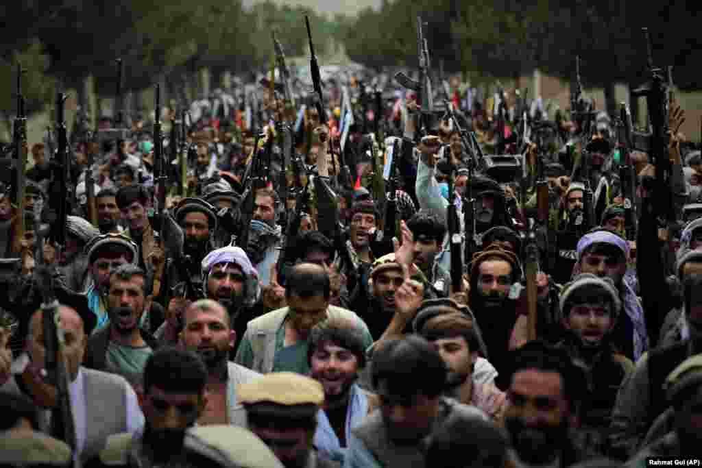 Afghan militiamen join their country's defense and security forces during a gathering in Kabul in a show of solidarity against the Taliban.